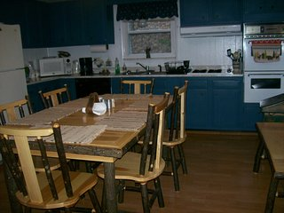 fully equipped kitchen with amish style dining set with bench also