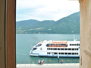 Tremezzo Tower Como with lake view and ferry boat, Tremezzina