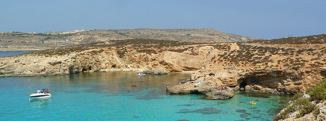 Crystal clear waters of the Blue Lagoon in Comino, accessible by foot ferry from Gozo.
