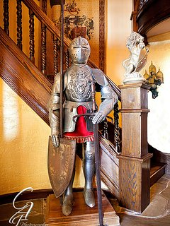 Suit of Armor at base of grand stairway is also a doorbell.