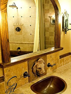 Hand-made hammered copper sink in the private bathroom of The Royal Bedroom.
