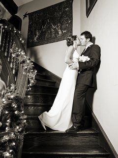 Stealing a kiss on the grand staircase.