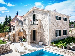 1.5km from the sea, for 14-20 people with a 2 large pools Old Stone Villa