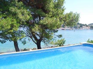 beachfront villa, pool, direct beach access, in small village with sandy beach