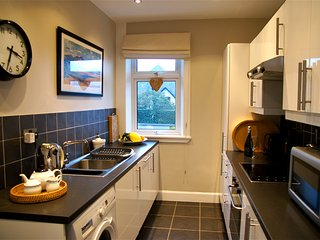 Modern kitchen well equipped inc dishwasher, microwave, washing machine