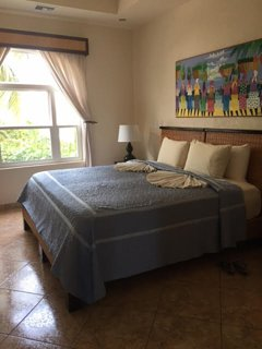 Guest bedroom with views of the garden. King bed can be converted to 2 twin beds.