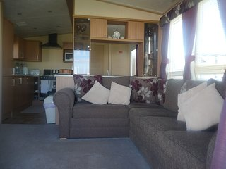 Spacious, modern living room with gas central heating.