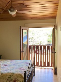 French doors in the bedroom open onto Juliette balcony overlooking the yard