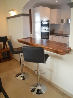 Breakfast bar looks onto Kitchen