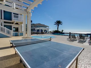 Dog-friendly beachfront condo with views & beach access, pools & hot tub!