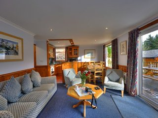 Luxury self-catering lodges set in a tranquil glen with commanding views of Loch