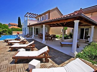 Luxury beachfront villa with infinity pool with direct beach access, Supetar