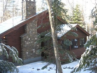 Wooded log home nestled in the Adirondacks
