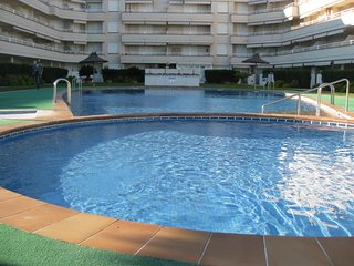 Apartamento bajo con jardin, 1a linea de la playa Carregador, Alcossebre