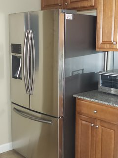 Samsung 28-cubic foot, French-door, stainless door refrigerator in the kitchen.
