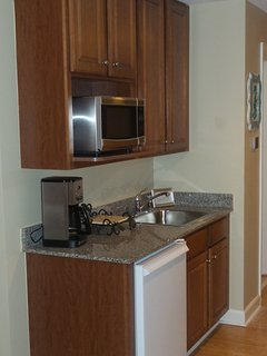 Kitchenette in master bedroom (2nd) with microwave oven, refrigerator and coffee maker.