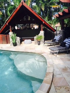 Private Tiki hut with pool sun loungers