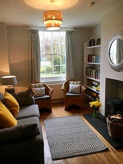 Snug sitting room with TV, DVD player, books, games and toys