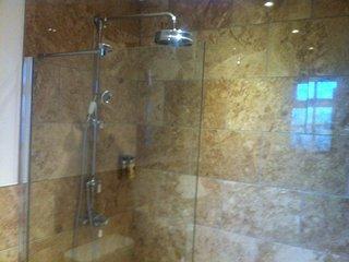 Luxury walk in waterfall shower