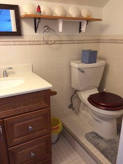 3rd floor half bath in room with two queen beds