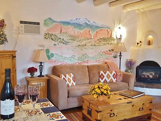 Sitting room; Original wood floors, ceiling vigas, kiva gas fireplace. Views to mountains.