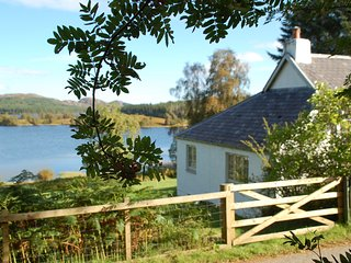 Brachkashie is a beautiful cottage which sits on the shore of Loch Knockie., Whitebridge