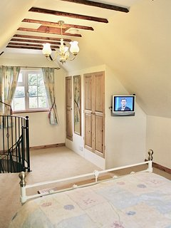The bedroom, with views to the countryside.