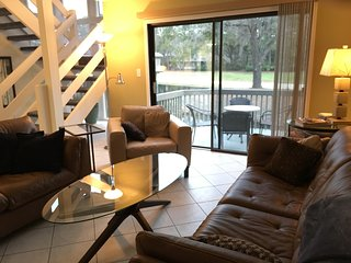 Living area looks out to deck and golf view