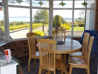 Sunny conservatory for meals & coffee/tea times