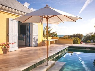 Coccoloba Beach House, a 2BR with Private Pool on Taylor Bay Beach