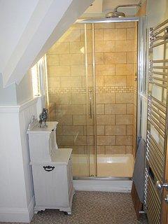 Double width shower enclosure