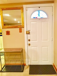 Private entry door, with hanging mirror for that last minute once-over!
