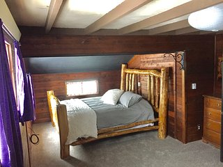 Master bedroom - with a king bed and twin bunk beds
