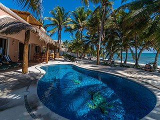 4 BR Beachfront home with upscale bedding, pool, Wifi. Close to Tulum.