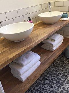 Luxury bathroom with twin sinks, heated mirror and towel radiator