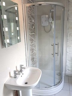 2nd Bathroom, is quite large - plenty of room to spread out and enjoy a good hot shower.