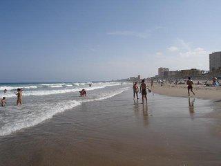 Playa de San Juan al atardecer, mirando al Cabo de las Huertas