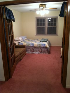 1 bedroom suite with a queen bed, sofa, chair and desk and an attached bath, Dayton