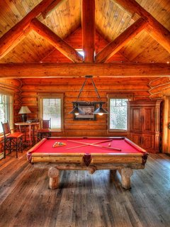 Minnie's Cabin Pool Table  - Challenge your friends to a game of pool.