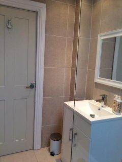 Luxurious bathroom with heated towel rail