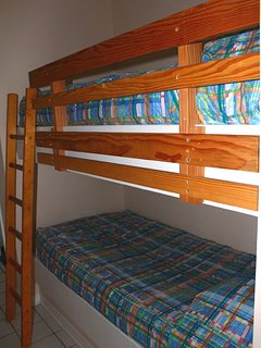 Kids love the twin size bunks in a private area adjacent to the bedroom.