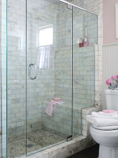 All our 5 bathrooms in all the villas are much the same with frameless glass shower doors