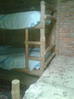 Sturdy bunk beds anchored to the wall designed to support heavy adults.