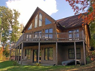 Like the name implies, Four Seasons Paradise is a treasure all year long! This cabin surrounds you in the warmth of golden pine and oak- inside the home and out., McHenry