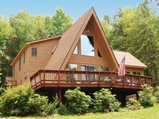 Picture the quintessential vacation retreat: a wooden A-frame masterpiece where colors explode along the forest edge. Did you see Lakeview Cottage? You should have!
