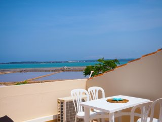 Formentera Apartment, balcony and large roof terrace with sea views, sleeps 2/4, La Savina