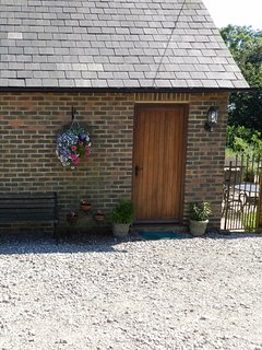 The annexe has its own entrance and gate to a private garden.