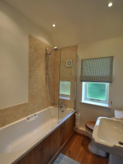 The Bathroom with bath and integral shower