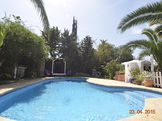Villa Eulalia is set in private lush gardens walking distance to Beaches.