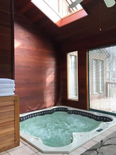 Indoor spa room with wrap around windows